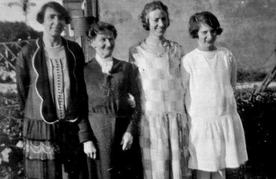 A group photograph with Harriet and Maude Finnis in the middle