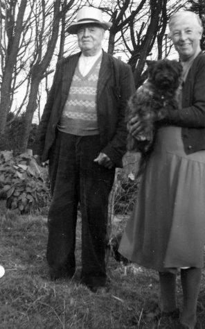 Annie Sharpe with her father and a small dog