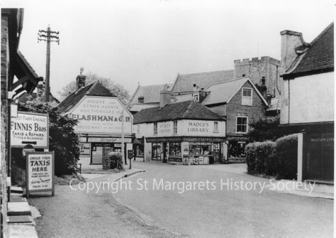 High Street, Post Office, Madge's Stores and Finnis Taxis.  pre 1962