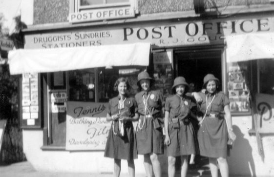 Girl Guides outside the village Post Office. 1934