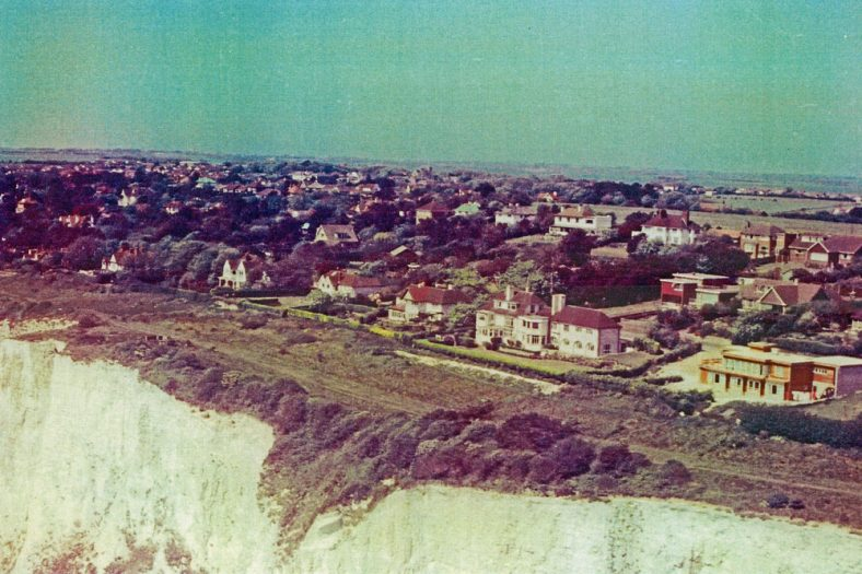 Aerial view looking across The Leas towards the church