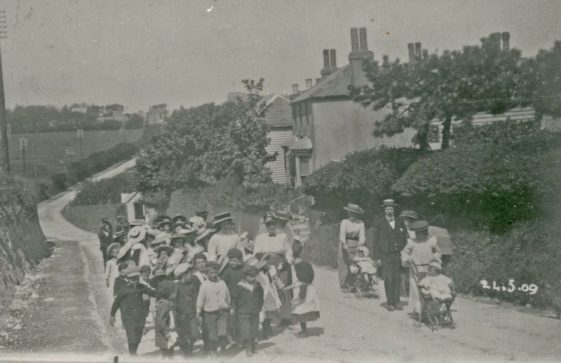 Children from St Margaret's School marching to the Coastguard Station Bay Hill to celebrate Empire Day. 1909