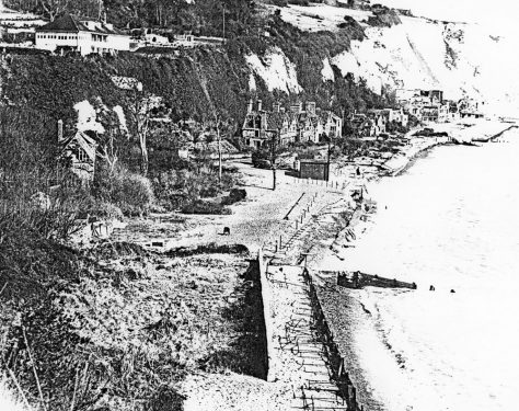 WW2 damaged buildings on the seafront in St Margaret's Bay.  c1945