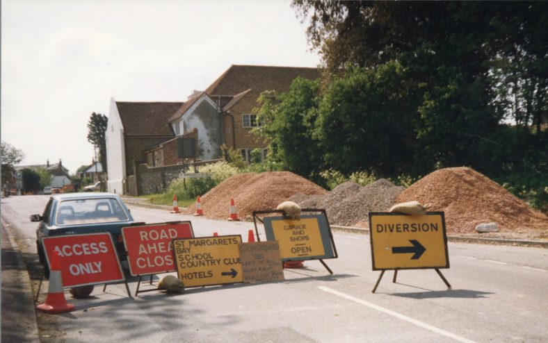 Road works - signs, instructions and diversions at the junction of Dover Road/Station Road. 1986