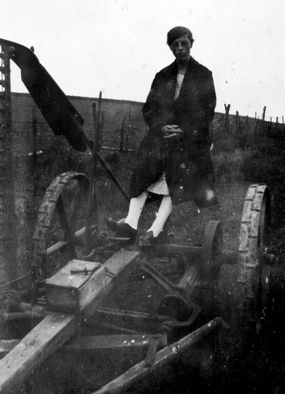Annie Sharpe on a part of tractor equipment.
