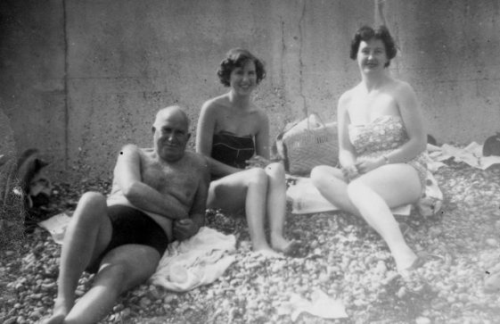 Denoon friends relax after swimming at St Margaret's Bay. c1956