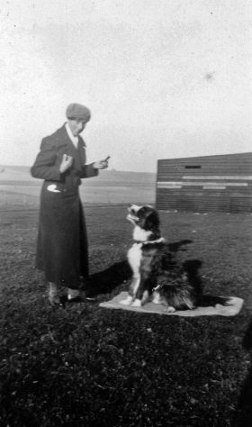 Annie Sharpe with her dog at Bockhill Farm
