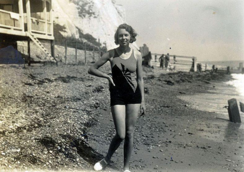 Molly Wyatt in a bathing costume on the beach. 1930