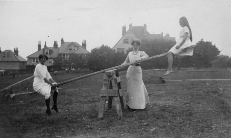 Girls on a see-saw. 1912