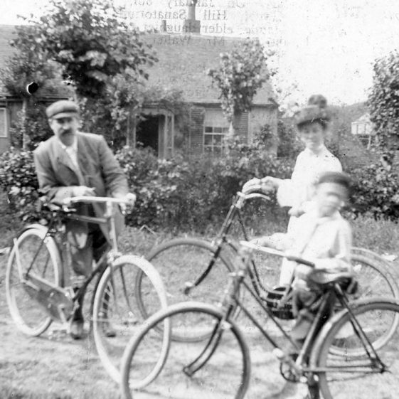 Madge family members with their bicycles at Erin Cottage