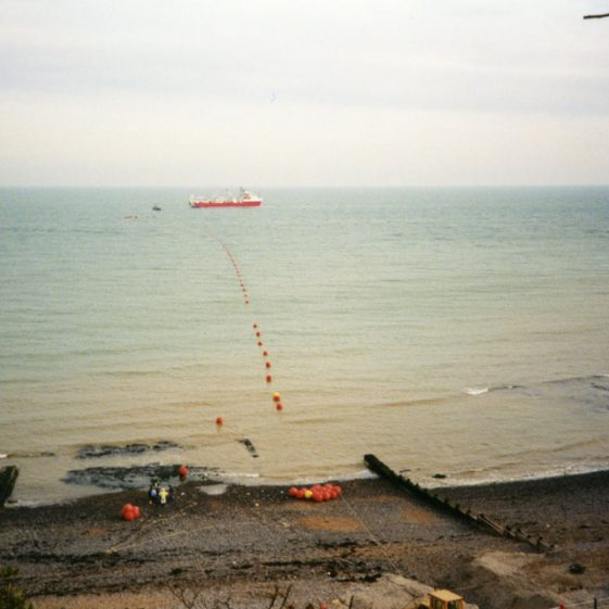 French cable ship Fresnel laying a new cable into the Bay. 16 September 1977