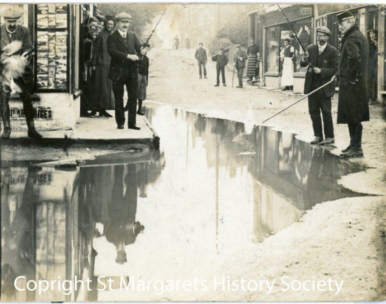 Flood water in the High Street.  Postmark 1 December 1910
