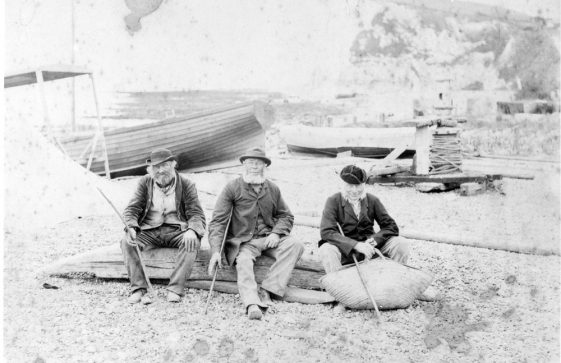 Three fishermen on the beach in the Bay. Probably late 19th Century