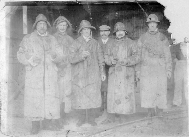 Group of men in Sou'westers. c1906