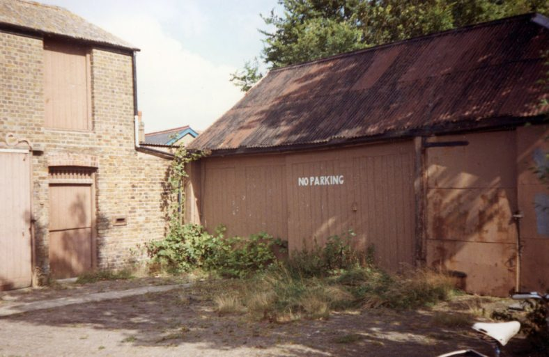 Jenner's Garage forecourt (dilapidated and overgrown), Chapel Lane. 1984
