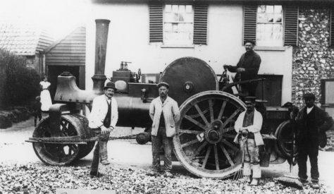 Village Steam roller and road mending gang. July 1905