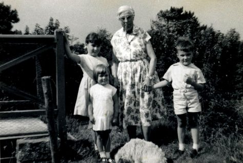 Annie Sharpe with a group of young children