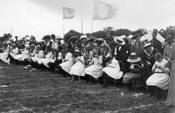 Girls sewing at the start of a race at St Margaret's Sports Day. c1910