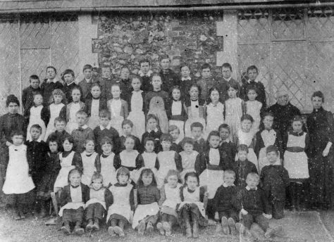 Pupils with teachers Mr and Mrs Hall, National School Kingsdown Road. c1900