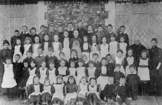 National School pupils with teachers Mr and Mrs Hall. c1900