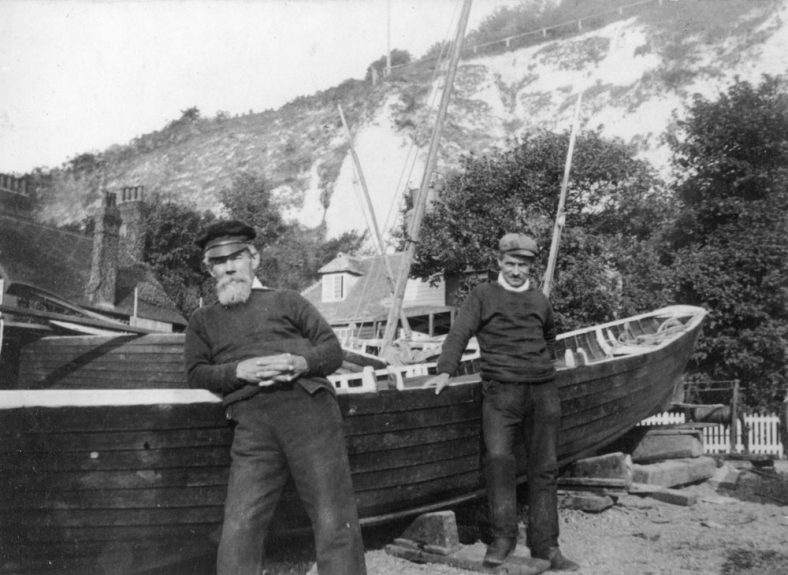 Fishermen and boats on St Margaret's Bay beach. After 1886