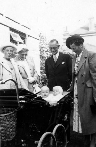 Annie Sharpe and others with twins in a pram. c1951