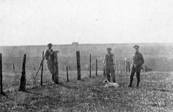 Bockhill Farm: Two farmworkers with serviceman. Undated