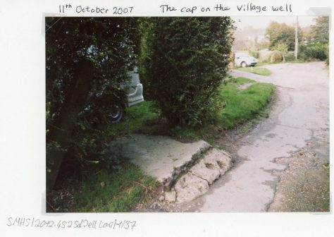 The cap on the village well, Well Lane. 2007
