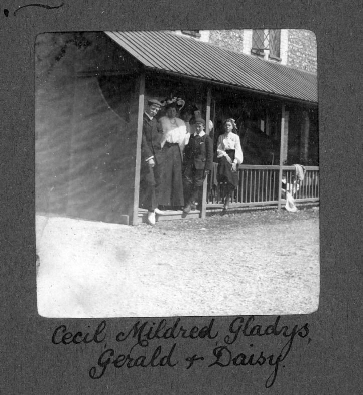 Five people on a veranda of a house in The Bay, 1906