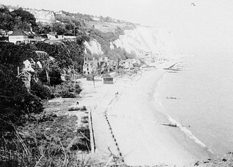 War damaged village on the beach. c1945