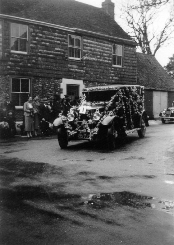 Eric Finnis with his car decorated for the King George VI coronation celebrations, outside the Red Lion