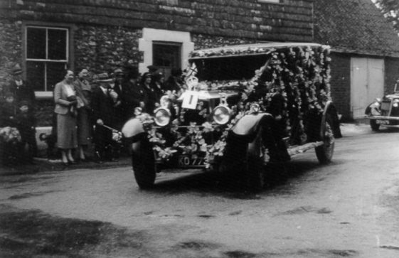 Eric Finnis with his car decorated for the Coronation of George VI, standing outside the Red Lion