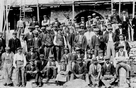 A group of builders with grandfather Clayson identified.