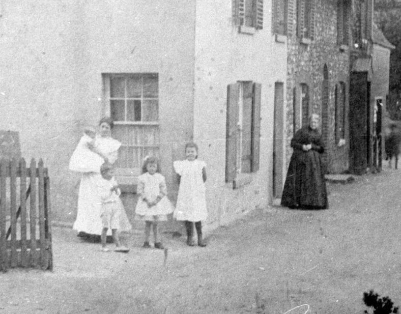 A Family group in the High Street. Date unknown