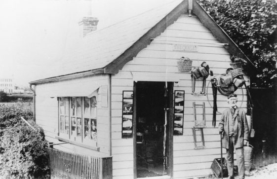 "Sea Street: ""The Chalet"" open for business with the proprietor, Henry Sproston, standing outside"
