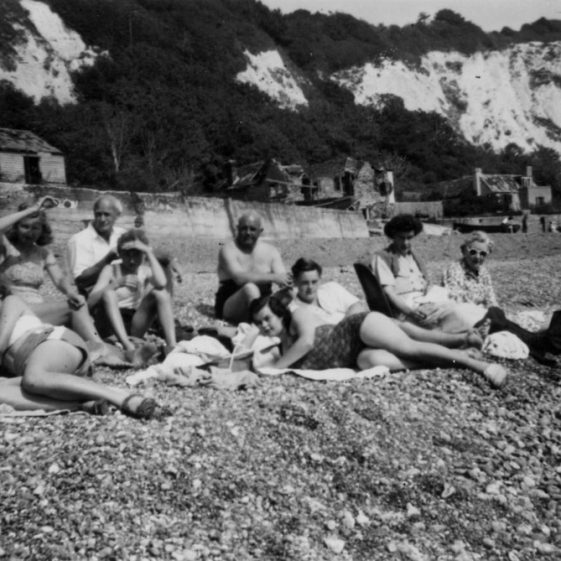 On St Margaret's beach with war damaged houses in the background. 1948