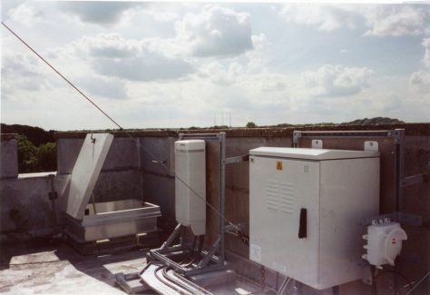 Mobile telephone mast equipment on roof of church tower.  23 August 2005