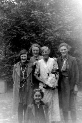 Annie Sharpe with four Girl Guides