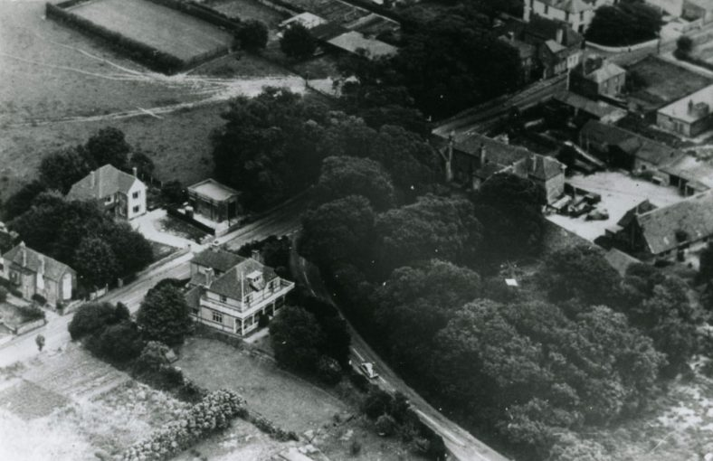 Aerial view of buildings at the junction of Station Road and Dover Road.