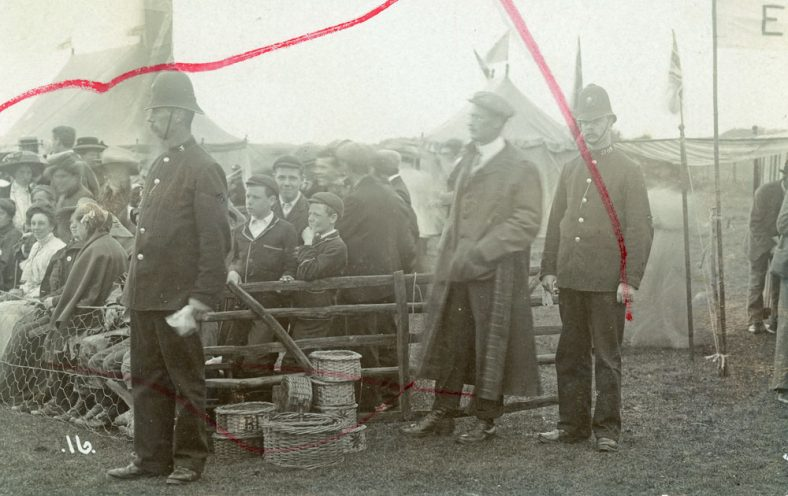 Spectators and two policemen at St Margaret's Sports Day. 1909