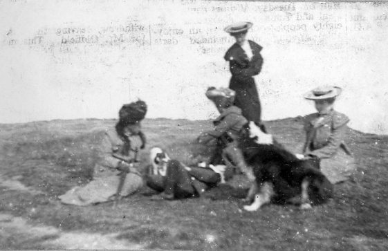 Group of people on the cliffs. c1905