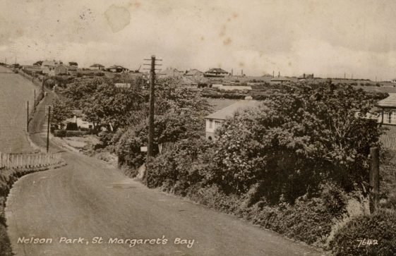 Station Road with Cliffe Place on right, Nelson Park in the distance. postmark 1957
