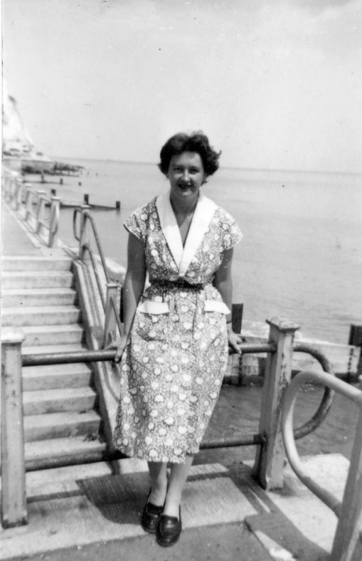 Heather Denoon on the steps of the promenade. c1956