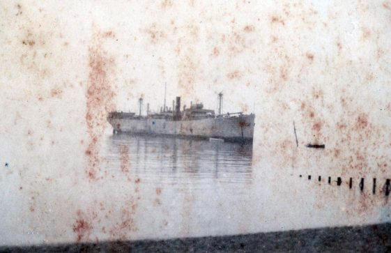 Cargo ship aground. Location, date and ship name unknown