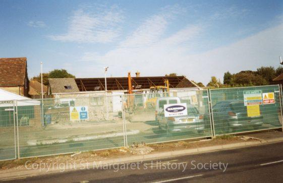 Knoll Garage, High Street.  Fenced off for demolition works.  September 2003