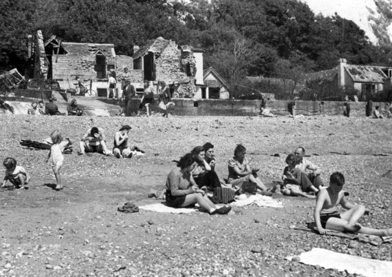 On St Margaret's beach with war damaged houses in the background. 1945