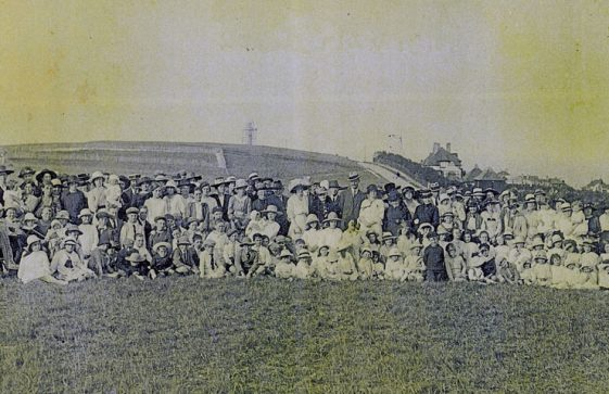 A group photograph of villagers with the Dover Patrol Memorial in the background 1920/1