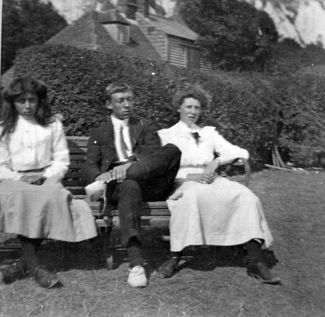 Three young people on a bench. 1900-1910