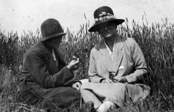 Kathleen and Mrs Gardner sitting in a field