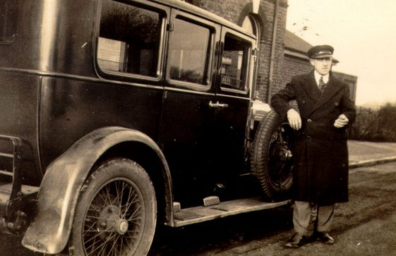 Eric Finnis and his taxi at Martin Mill Station.